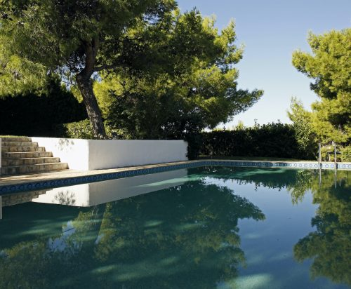 The Loutraki Green Villa swimming pool offers total privacy and is located under many pine trees.
