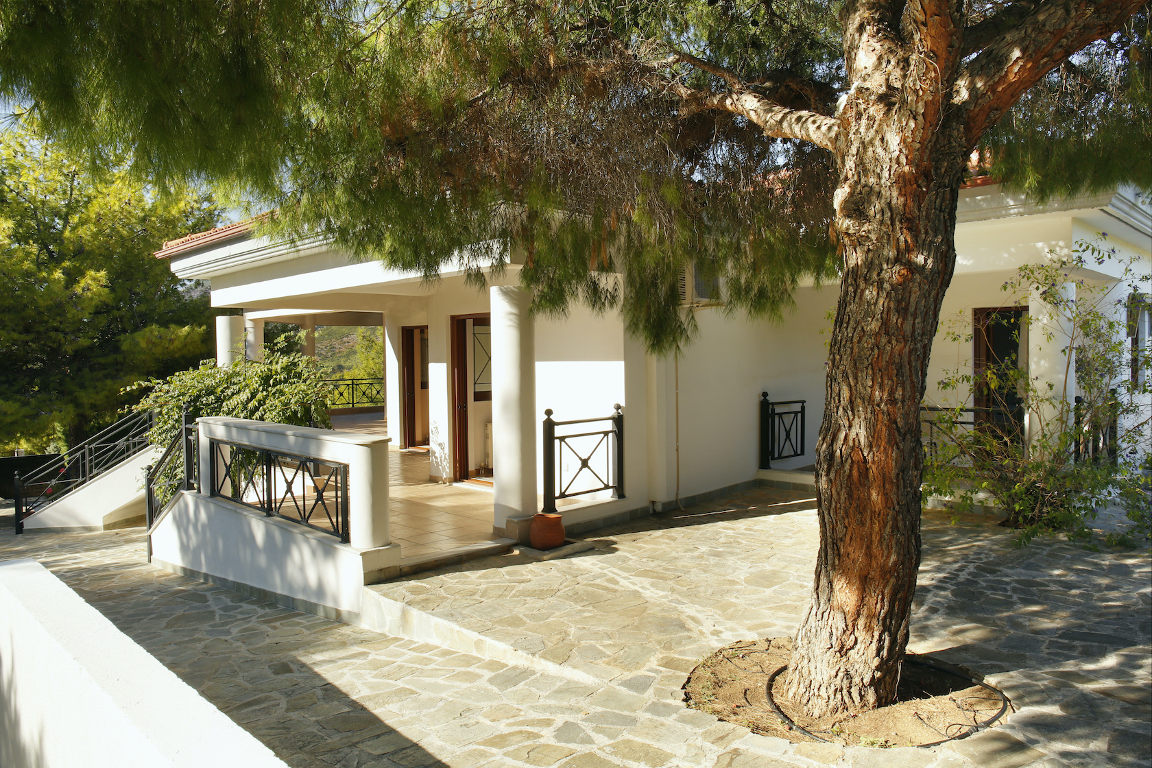 The Loutraki Green Villa side entrance with direct access to the first floor of the villa.